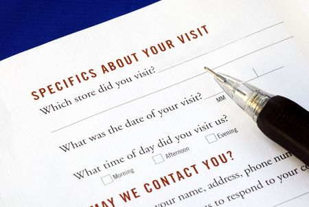 Customer fills in the feedback survey isolated on blue Stock Photo - 6752617