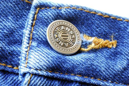 ripped: A button on the old blue jeans