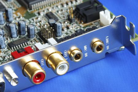 Close up view of a sound card isolated on blue photo