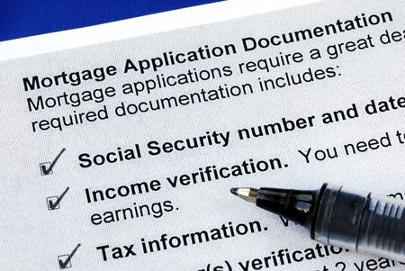 The documents required in a mortgage application isolated on blue photo