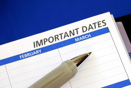 important: Write down some important dates in the notebook Stock Photo