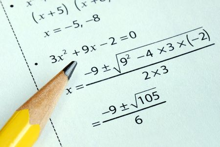 math: Doing some grade school Math with a pencil Stock Photo