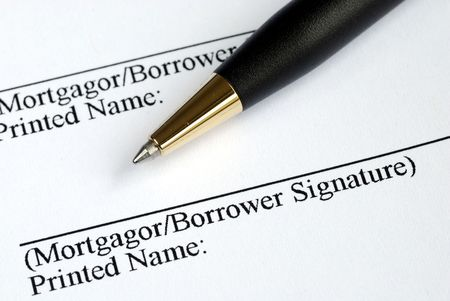 Sign your name here on the mortgage application photo