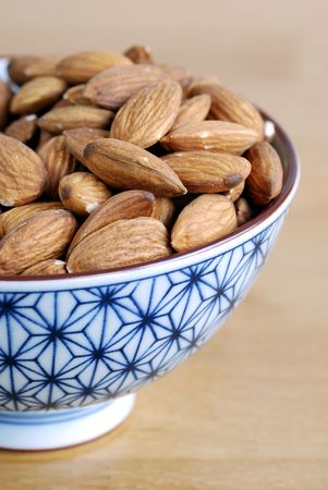Some almonds on a small Japanese bowl Stock Photo - 6752431
