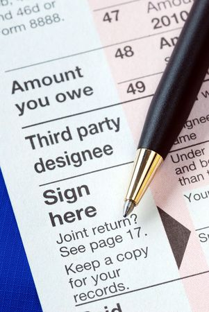 Sign the income tax return isolated on blue Stock Photo - 6752816