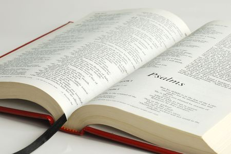 An opened bible focused on the word Psalms Stock Photo