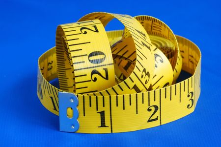 A measuring tape isolated on blue background Stock Photo - 6752758
