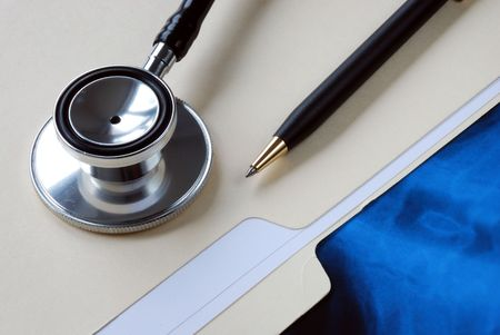 A stethoscope on the top of a medical folder Stock Photo