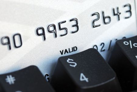 Credit card and keyboard concept online shopping or banking photo