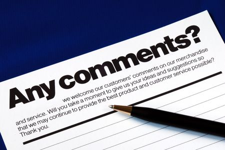 customer: Customer fills in the feedback survey isolated on blue Stock Photo