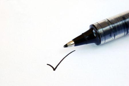 Write the tick on the white paper Stock Photo - 7001834