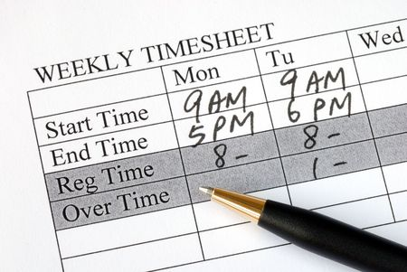 Filling the weekly time sheet for payroll photo