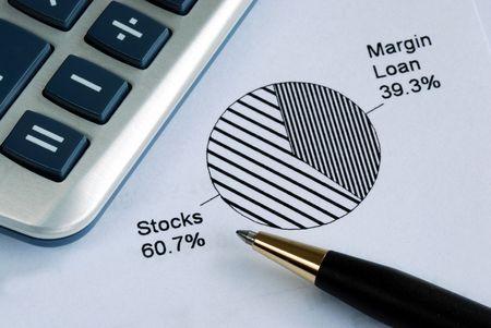 financial diversification: Portfolio allocation illustrates the asset in a pie chart Stock Photo