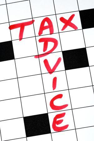 retour: Schrijf de woorden fiscaal advies in het kruiswoordraadsel Stockfoto
