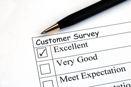 Customer fills in the feedback survey Stock Photo
