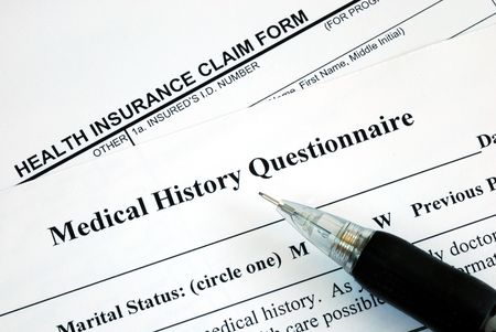Medical claim form and patient medical history questionnaire Stock Photo