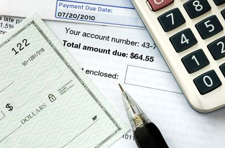Write a check to pay the bills on time photo
