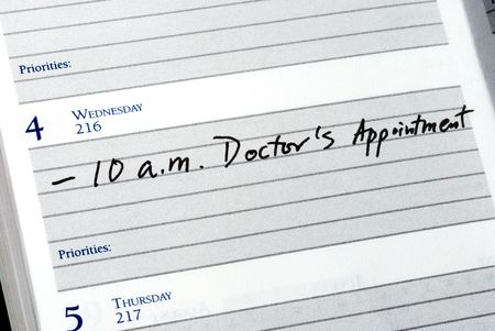 Mark the doctor appointment in the day planner Stock Photo - 7393621
