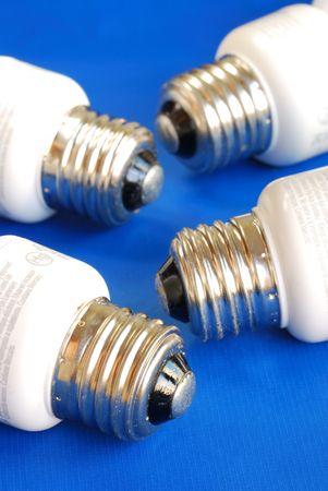 Light bulbs concepts of new ideas and green energy isolated on blue Stock Photo - 7393605