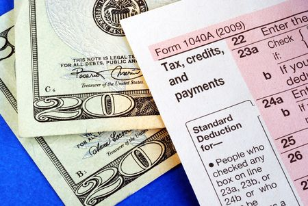 Getting refund from the income tax return isolated on blue photo
