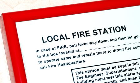 Instruction about the local fire station in a building photo