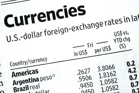 Check the foreign exchange rates from the newspaper Stock Photo - 7453511