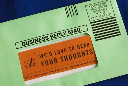 Send the customer survey in the business reply envelop photo