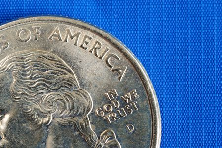 minted: In God We Trust from the quarter isolated on blue