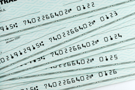 A pile of bank checks photo