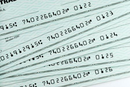chequera: Un mont�n de cheques bancarios