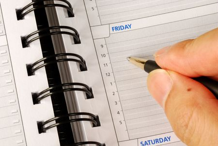 Write down what to do on Friday in the day planner  Stock Photo - 7453514