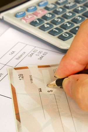 bill payment: Write a check to pay the bills Stock Photo