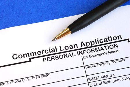 requesting: Complete the commercial loan application isolated on blue Stock Photo