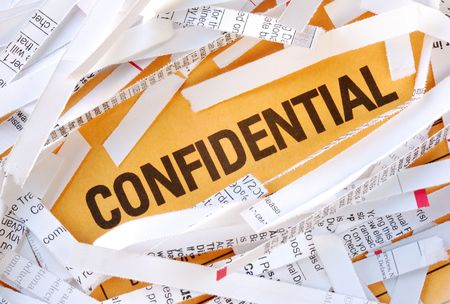 confide: The word Confidential surrounded by some shredded papers