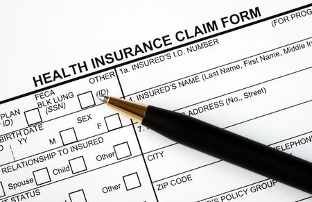 Patient fills in the medical claim form Stock Photo