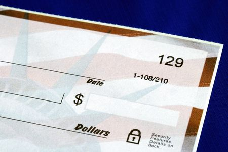 Write the dollar amount on the check isolated on blue photo