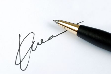 Sign the name on a paper with a pen photo
