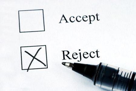 disapprove: Select the Reject option with a pen Stock Photo