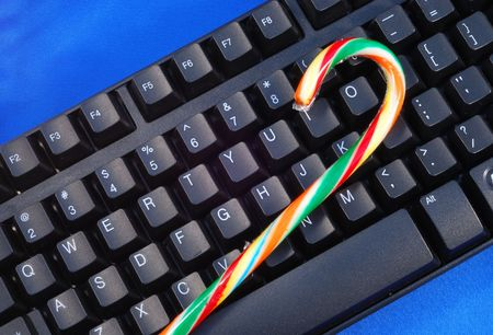 Christmas candy on a keyboard concepts of holiday online shopping photo