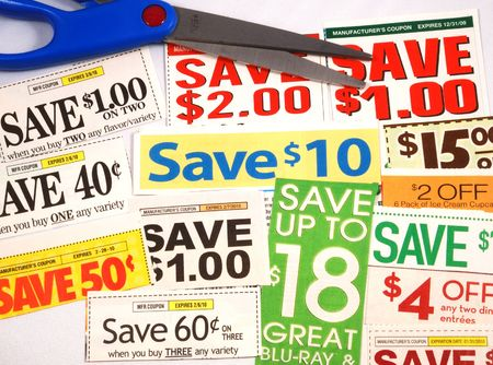 penny pinching: Cut up some coupons to save money  Stock Photo