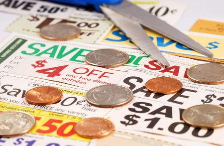 Cut up some coupons to save money  Stock Photo - 7541309