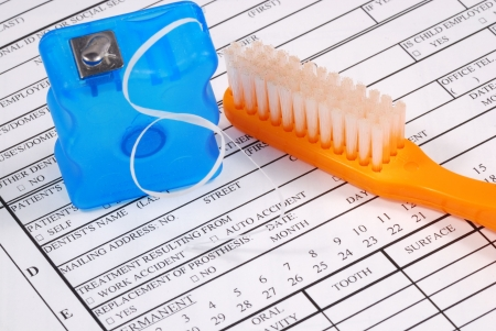 dental floss: Dental claim form with toothbrush concepts of the rising cost of dental care Stock Photo