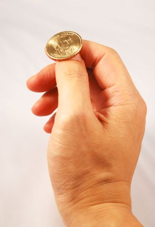 divining: Flipping a golden coin concepts of taking a chance Stock Photo