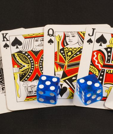 Blue dices on poker cards concepts of gambling or taking a risk