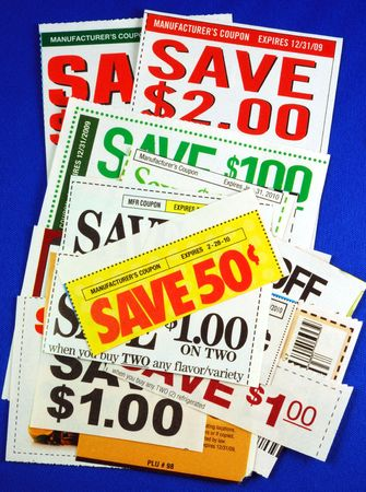 penny pinching: Stack of coupons concepts of saving money