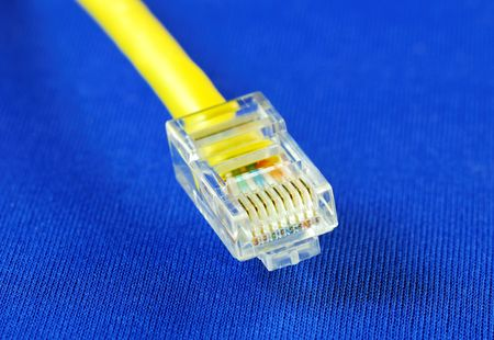 Close-up view of the yellow   (RJ45) cable isolated on blue