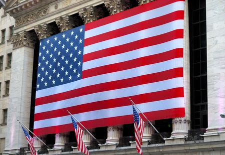 A giant American flag hanging in Wall Street Editorial