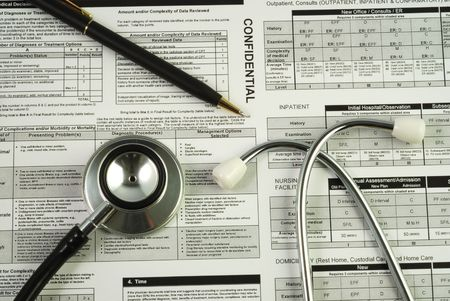 health facilities: A stethoscope on the top of a medical utilization document concepts of optimizing the medical benefit