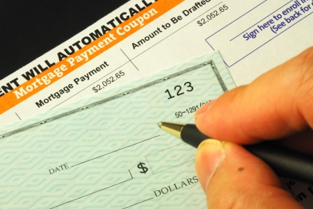 Paying the mortgage for the primary residence photo
