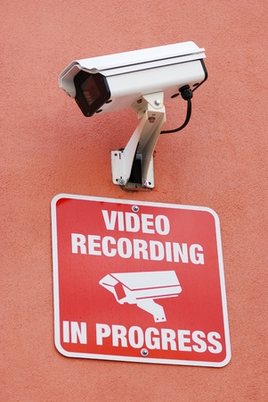 Security  surveillance camera with the warning sign photo